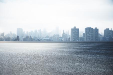 Photo pour Abstract asphalt and city skyline wallpaper - image libre de droit