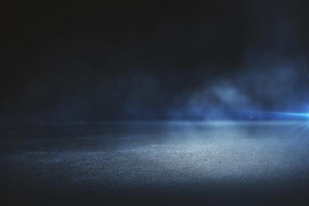 Creative blurry outdoor asphalt background with mist