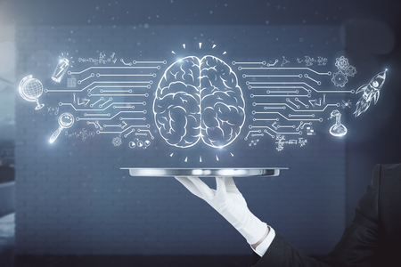 Hand holding silver tray with business brain sketch on blurry office interior background. Brain storm and finance concept
