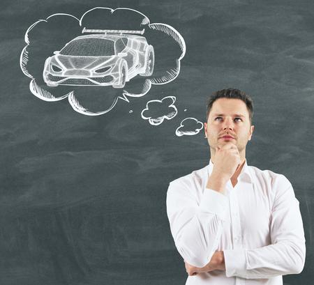 Businessman dreaming about sport car at school blackboard background. 3D render