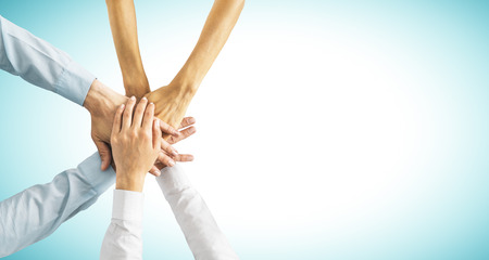 Photo pour Hands put together on blue background with copy space. Union, togetherness and teamwork concept - image libre de droit