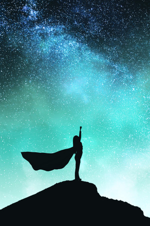 Photo pour Confident backlit superhero with cape silhouette standing on mountain and starry sky background. Success and confidence concept - image libre de droit