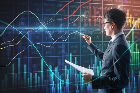 Foto de Handsome businessman with document in hand using creative forex chart interface on blurry background. Finance and trade concept. Double exposure - Imagen libre de derechos
