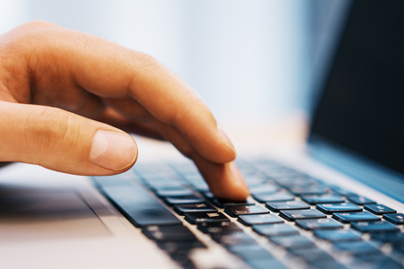 Photo pour Side view of businessman hands using laptop keyboard on desktop workspace. Blurry background. Education, communication, programming and software concept - image libre de droit
