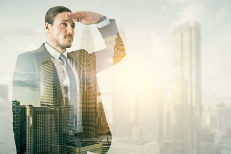 Photo pour Side view of young businessman on blurry bright city background. Research and success concept. Double exposure - image libre de droit