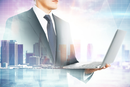 Photo for Side view of attractive young european businessman using laptop on blurry city background. Communication and success concept. Multiexposure - Royalty Free Image