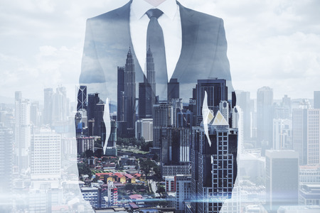Photo for Businessman standing on creative Kuala Lumpur city background. Success and future concept. Double exposure - Royalty Free Image