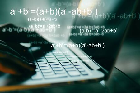 Photo for Programming and algorithm concept. Close up of hands using blurry laptop with mathematical formulas. Double exposure - Royalty Free Image