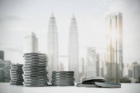 Photo pour Creative silver coin stacks on blurry Kuala Lumpur city background. Money and income concept. 3D Rendering - image libre de droit