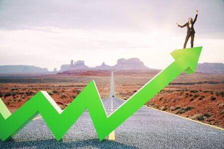 Foto de Happy businesswoman standing on upward green arrow on abstract road and desert background. Growth, development, success and increase concept. - Imagen libre de derechos