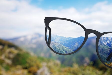 Foto de Creative nature view though eyeglasses. Blurry background. Vision concept - Imagen libre de derechos