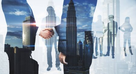 Foto de Meeting of businesspeople on abstract city background. Teamwork and success concept. Multiexposure  - Imagen libre de derechos