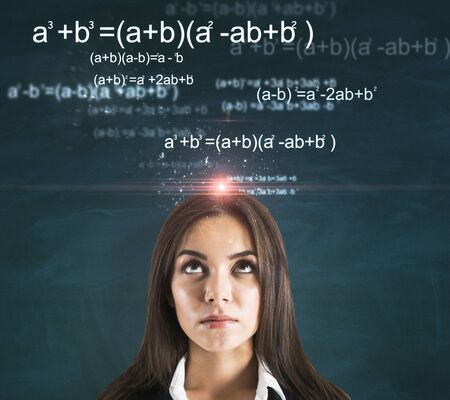 Photo pour Portrait of attractive thoughtful young european businesswoman with glowing mathematical formulas on chalkboard background. Complex and algorithm concept - image libre de droit