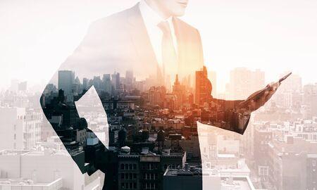 Photo pour Businessman standing on blurry city background with tablet. Success and career concept. Multiexposure - image libre de droit