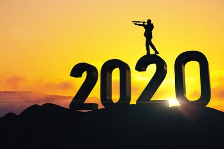 Foto de Businessman with telescope standing on 2020 new year text. Success and startup concept. - Imagen libre de derechos