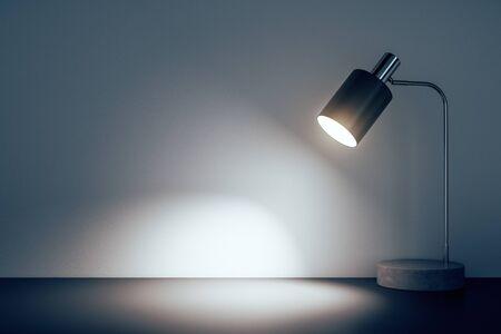 Photo pour Office table lamp on floor in concrete room. 3D Rendering - image libre de droit