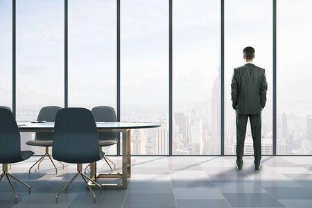 Foto de Businessmen standing in modern coworking meeting room. Occupation and worker concept. - Imagen libre de derechos