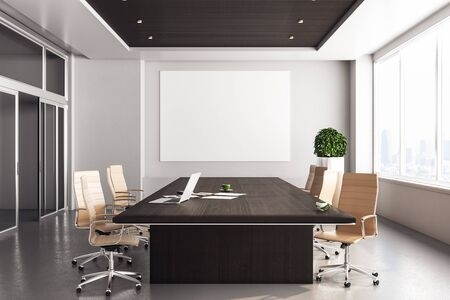 Photo pour Contemporary coworking office with laptop and blank poster on wall. 3D Rendering - image libre de droit