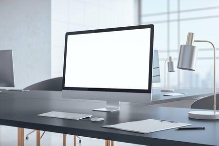 Foto de Minimalistic desktop with blank personal computer screen. Workplace and lifestyle concept. Mock up, 3D Rendering - Imagen libre de derechos