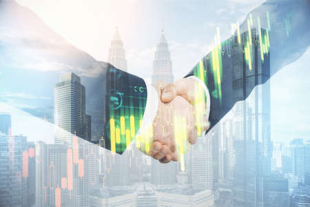 Photo pour Businessmen with glowing blurry ctock chart shaking hands on blurry city background. Teamwork and investment concept. Double exposure - image libre de droit