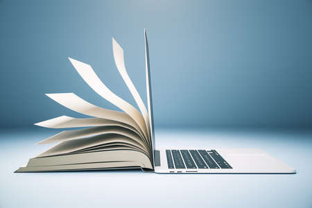 Foto de Abstract book and open laptop. Online education and webinar concept. 3D Rendering - Imagen libre de derechos