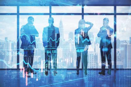 Foto de Pensive backlit businesspeople standing in blurry office with forex chart and city view. Meeting and stock market concept. Double exposure - Imagen libre de derechos