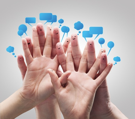 Photo for Happy group of finger smileys with social chat sign and speech bubbles - Royalty Free Image
