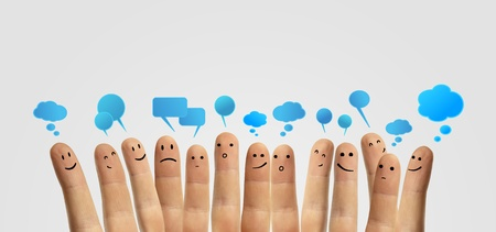 Happy group of finger smileys with social chat sign and speech bubbles  Fingers representing a social network