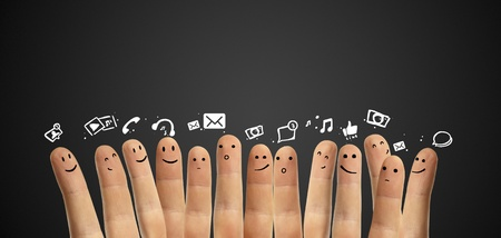Happy group of finger smileys with social chat sign and speech bubbles,icons  Fingers representing a social network