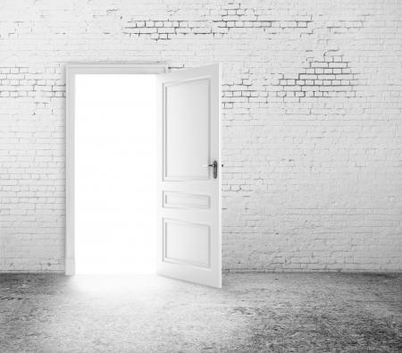 open door in white brick wall