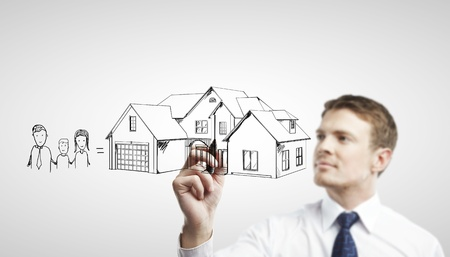 businessman drawing House on a white background