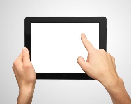 Photo pour hands pushing tablet on gray background - image libre de droit