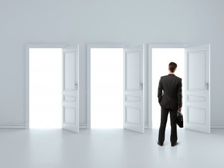 Photo for man in gray room with tree open doors - Royalty Free Image