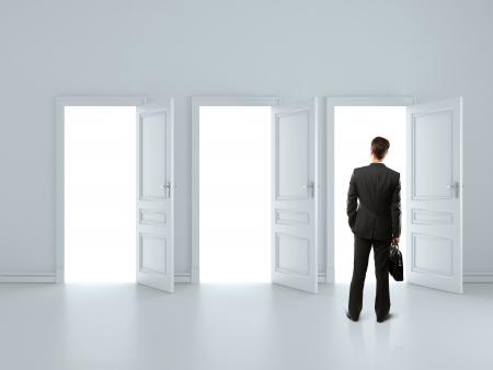 man in gray room with tree open doors