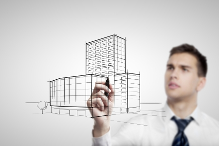 businessman drawing skyscraper on white background