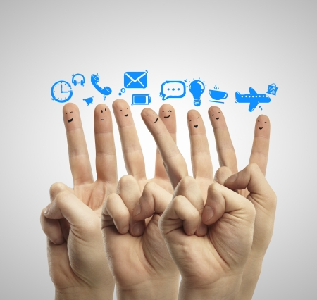 Photo for happy group of finger smileys with social media icons - Royalty Free Image