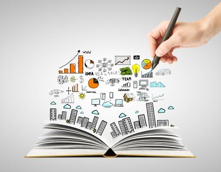 Foto de hand drawing business concept and open book - Imagen libre de derechos