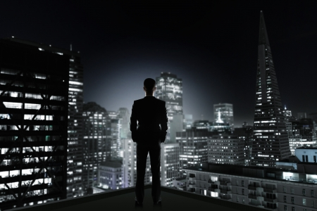 man in office looking to night city