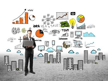Foto de businessman with notebook and business plan - Imagen libre de derechos