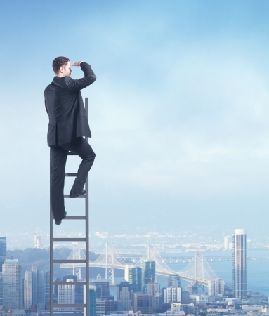 man climbing on ladder, urban business concept