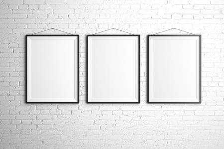 three black frames on brick wall