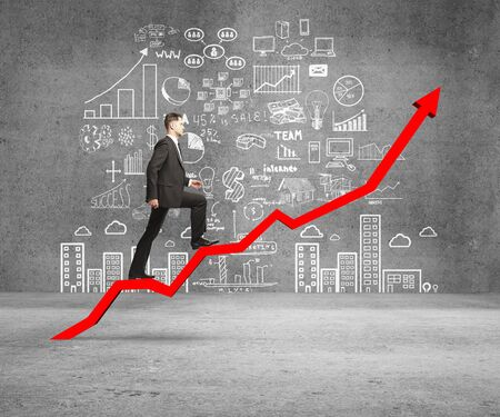 Foto per businessman rise on chart and drawing concept on wall - Immagine Royalty Free