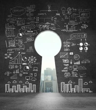 Foto de opened concrete wall in form of a keyhole with drawing business concept - Imagen libre de derechos