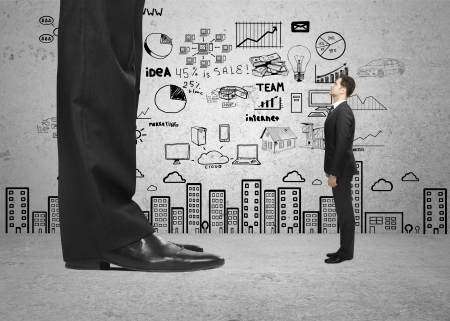 big foot and small businessman and strategy on wall