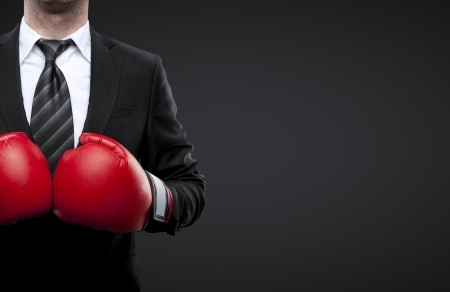 man in boxing gloves isolated on black