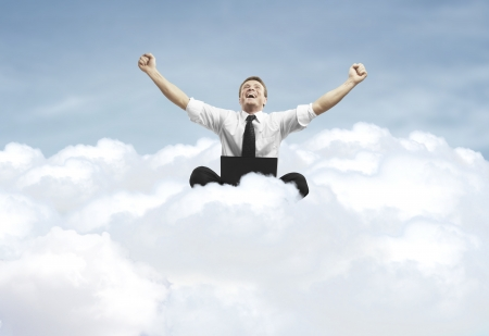 Photo for businessman admiring his success in cloud - Royalty Free Image