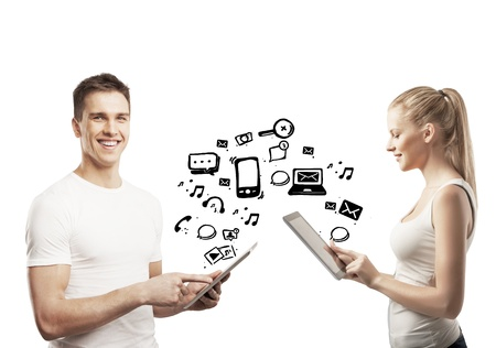 young man and woman holding pad with social icons