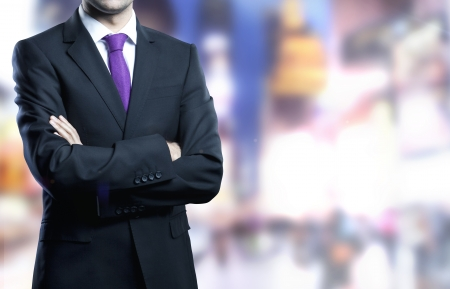 man standing in suit and city onbackground