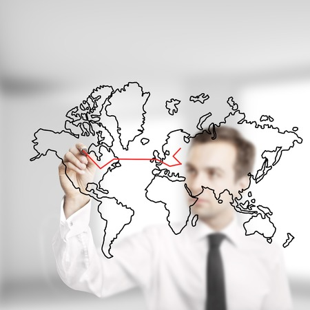 businessman drawing abstract world map