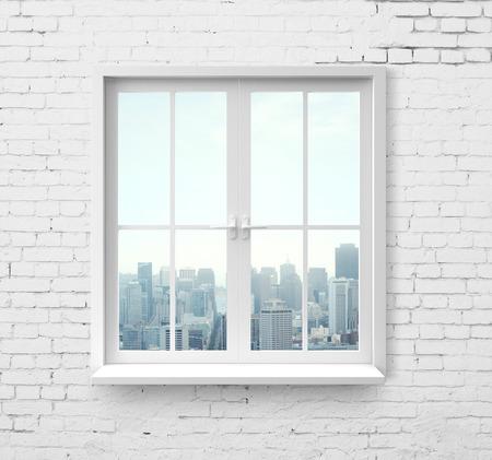 Foto de Modern window with skyscraper view in brick wall - Imagen libre de derechos